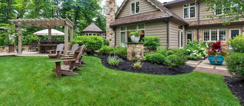 Beautiful landscaped backyard with patio