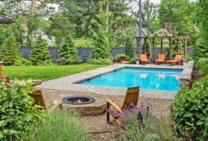 firepit and pool in backyard
