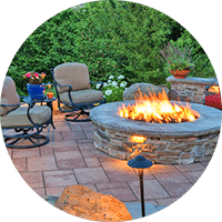 beautiful landscaped patio with firepit